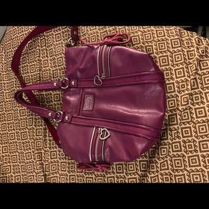 Purple leather coach purse